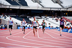 Running at the olympic stadium. LONDON - MAY 6: London prepares series at the Oympic park in London on May 6, 2012. The London Prepares series is the official Stock Photos