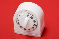 Running out of time. Close-up of egg timer running out of time Royalty Free Stock Photography