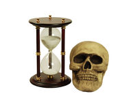 Running out of time. Hour glass used to measure time, Skull with eye sockets and teeth Stock Image