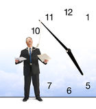 Running out of time business deadline stress. A business man is minutes away from being hanged by a clock with a noose hanging from it that is around the Stock Photo