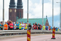 Running over the famous Vasterbron bridge with Hogalids church i Royalty Free Stock Image