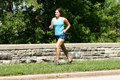 Running At The Park. Keeping fit by running at the local park, Denise likes to be active Royalty Free Stock Photography