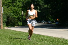 Running At The Park. Keeping fit by running at the local park, Denise likes to be active Stock Photos