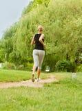 Running in park stock photo