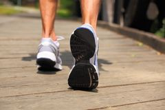 Running in park - close-up on sport shoes and legs stock photo