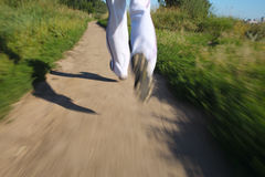 Running in the park. Detail of legs Stock Photo