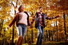 Running through park- happy couple. Running through autumn park -happy couple Royalty Free Stock Images