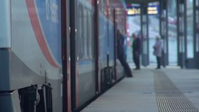 Running passengers and conductor entering train, transportation services. Stock footage stock video