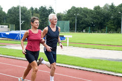 Running Pensioners. Two running pensioners having a healthy lifestyle Royalty Free Stock Image