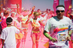 Running people at a color run in Cologne Stock Photos