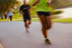 Running people in park Stock Image