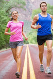 Running people - two runners jogging Stock Images