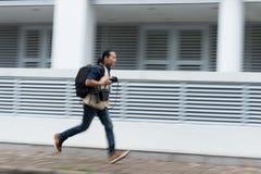 Running photographer Stock Photo