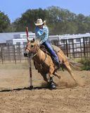 Running the poles. Pole bending at a rodeo Stock Image