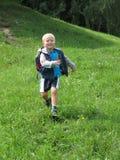 Running preschool boy. From a hill royalty free stock photos