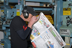 Running the press Stock Image