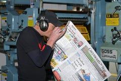 Running the press Stock Image