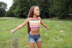 Running preteen girl Stock Photography