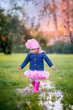 Running on puddles Royalty Free Stock Photography