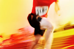 Running a race motion blur number has been changed Royalty Free Stock Photo