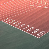 Running race track number screen on ground Royalty Free Stock Photos