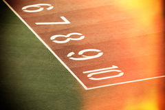 Running race track number screen on ground surface Royalty Free Stock Photo