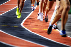 Running a Race on a Track Sports Competition. Running a race on a track for sports competition and winning stock photos