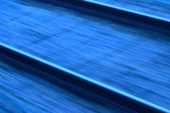 Running Railways Abstract Background Photo. Beautiful running railways captured from the running train in India. Speedy railways in motion with blue coloured Royalty Free Stock Image