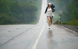 Running in the rain Royalty Free Stock Photos
