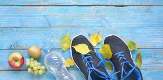 Running and reducing weight in the autumn,air of runners a. Running and getting fit, reducing weight in the autumn, pair of runners and fruit, free copy space royalty free stock image