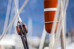Running rigging gear ship tackles. Running rigging gear and sailing rope. Ship tackles on on board yacht Royalty Free Stock Photography