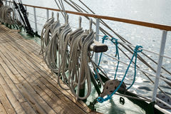 Running rigging of a sailing ship against sea water Royalty Free Stock Image