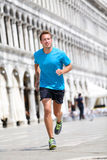 Running runner man jogging in Venice. Male sport athlete training on travel vacation as tourist on Piazza San Marco Square, Venice, Italy, Europe stock photo
