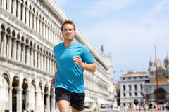 Running runner man jogging in Venice Stock Photo