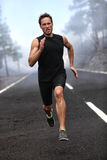 Running runner man sprinting workout on road stock photography