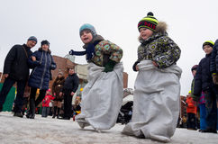 Running in sacks on national holidays during Shrovetide the celebration Stock Photos