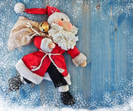 Running Santa Claus. Soft toy. Royalty Free Stock Photos