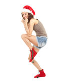 Running Santa girl Royalty Free Stock Photography