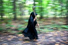 running scythe för död Arkivfoton