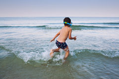 Running into sea Stock Image