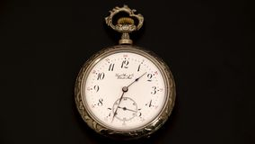 Running second hand on an old vintage pocket watch . Black background. Time lapse. Running second hand on an old vintage pocket watch with a white dial. Black stock video footage