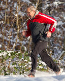 Running senior in snow. Senior running in the snow Royalty Free Stock Photography