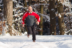 Running senior in snow. Senior running in the snow Stock Photography
