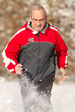 Running senior in snow. Senior running in the snow Stock Photos