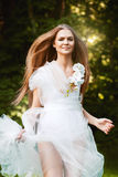 Running sensual woman in white dress Stock Photography