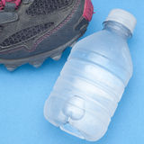 Running Shoe with Bottle of Water Royalty Free Stock Photo