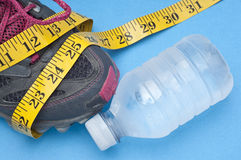 Running Shoe with Bottle of Water Royalty Free Stock Photography