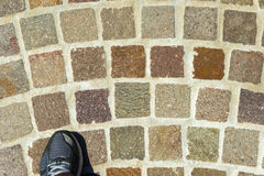 Running shoe Cobblestones Royalty Free Stock Image