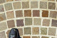 Running shoe Cobblestones Royalty Free Stock Image