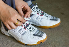 Running Shoes. The Girl Tying Running Shoes Stock Photo